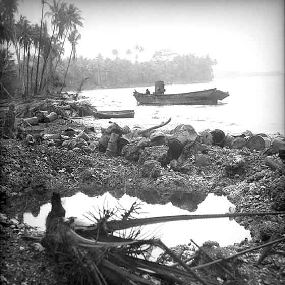 The Battle of Milne Bay, (25 August – 7 September 1942). One of the barges used by the Japanese forces in their unsuccessful incursion.