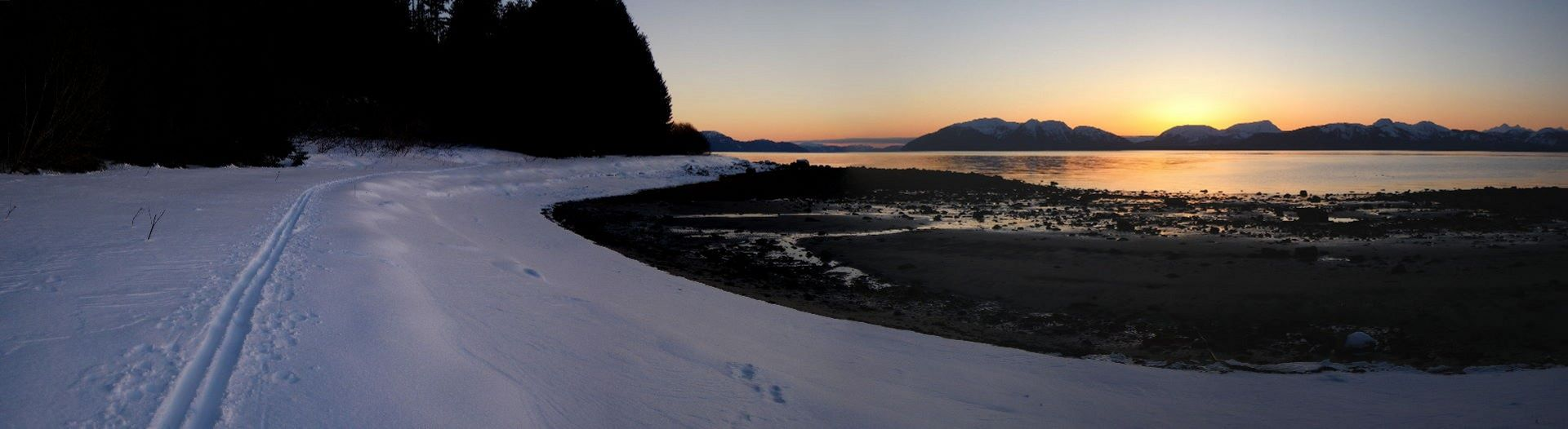 Winter ski-ing in the upper intertidal next to the ocean in the short days.