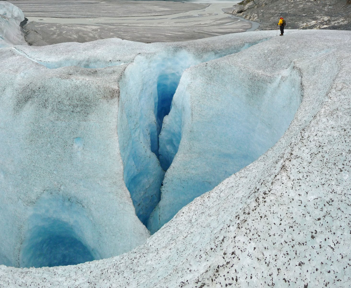 A 'moulin' – a hole in the ice where water running across the glacier plunges down into the interior of the glacier.