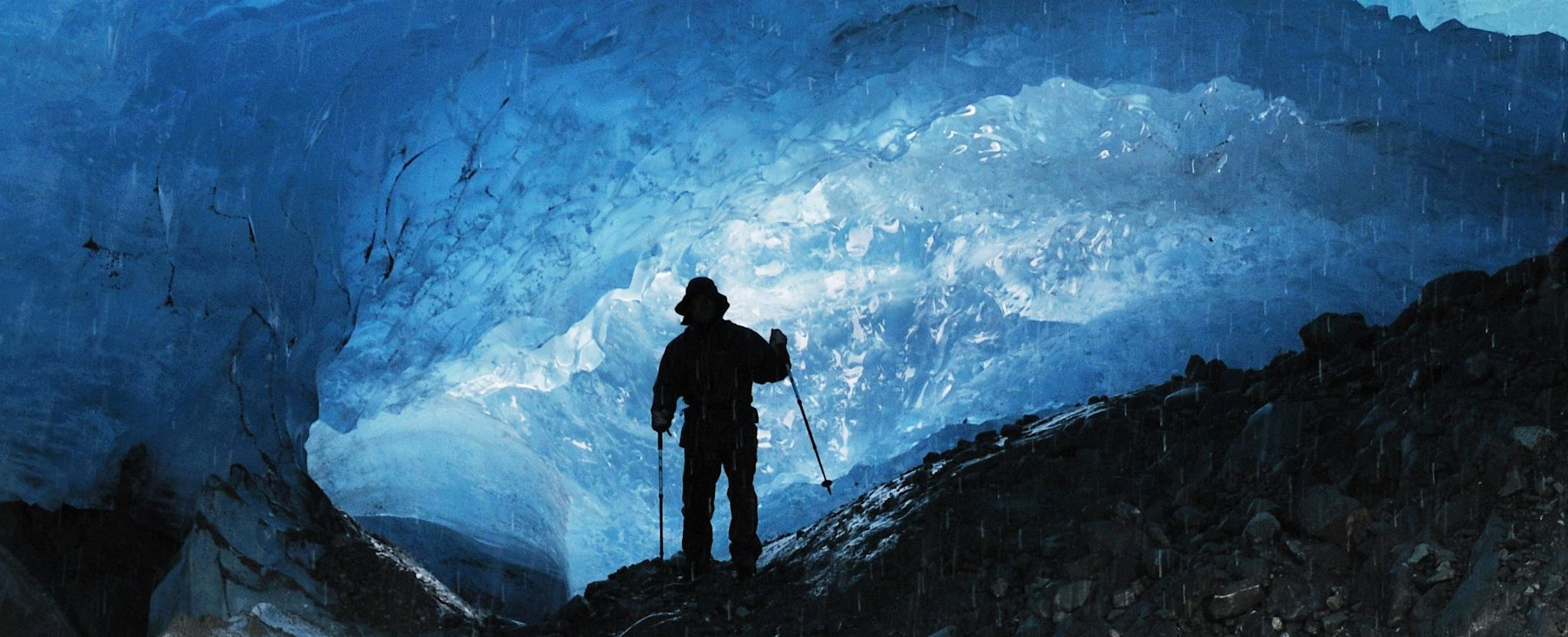 Water dripping from the roof of a moving glacier.