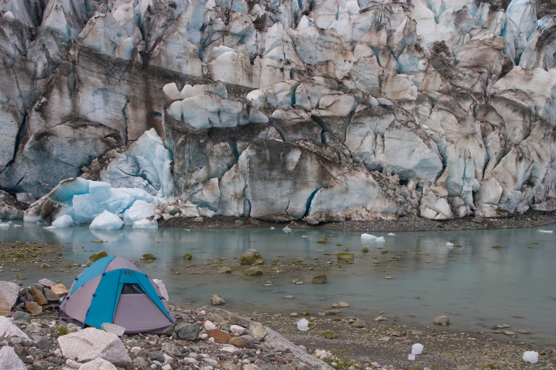 Camping next to a glacier with the cold wind coming off the glacier.