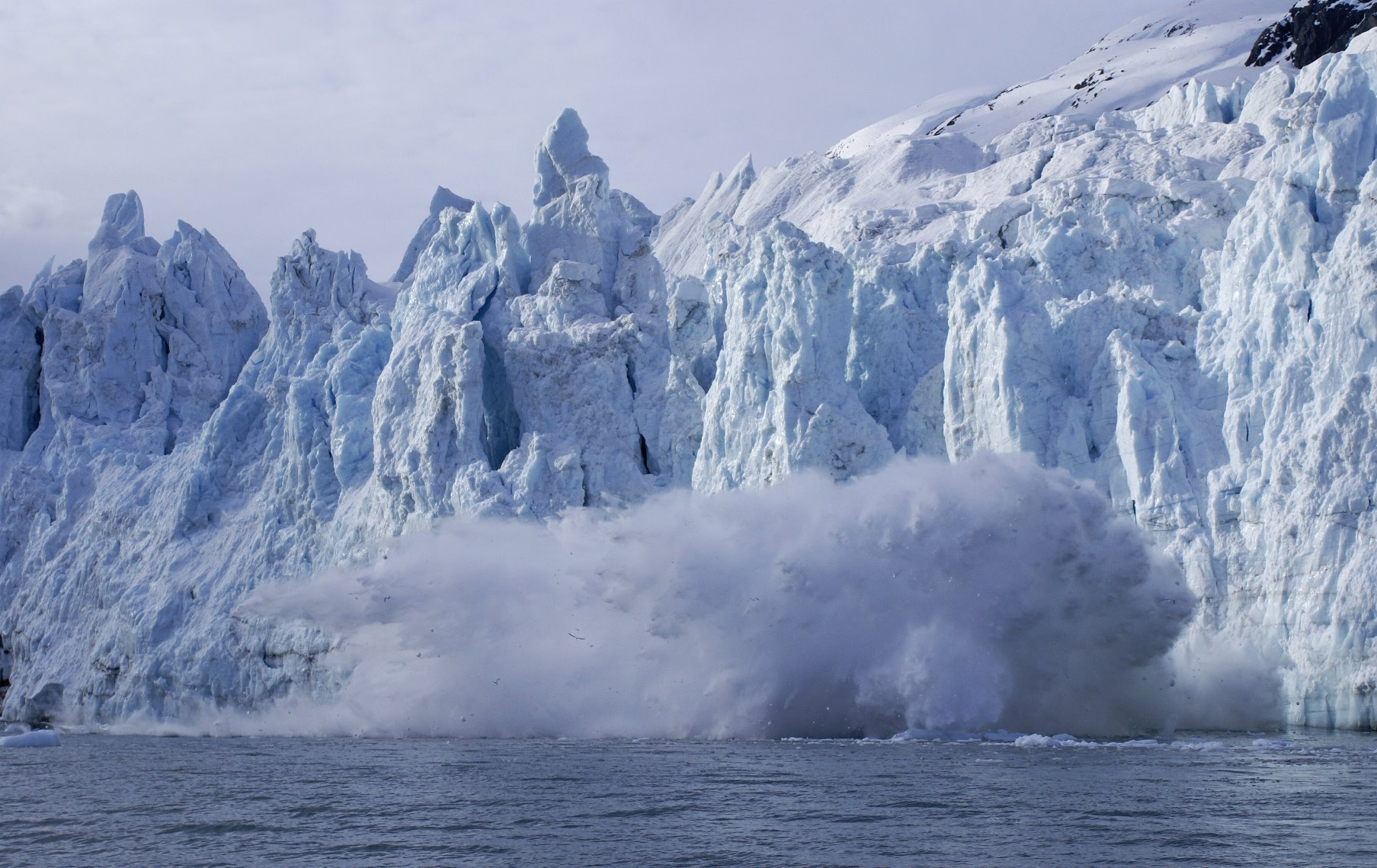 Big ice calving off the face of Margerie Glacier - over 200 feet high, causing a 100 feet splash.