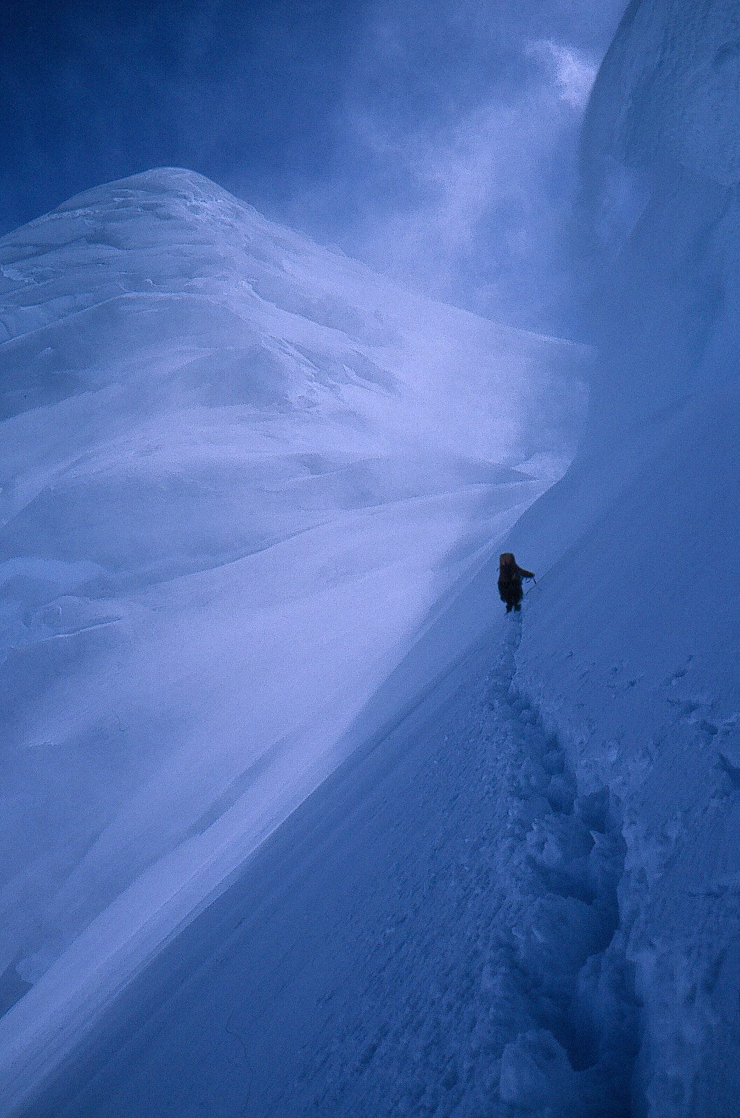 Traversing under a cornice on the way to the high saddle on the west ridge of Mount Fairweather.