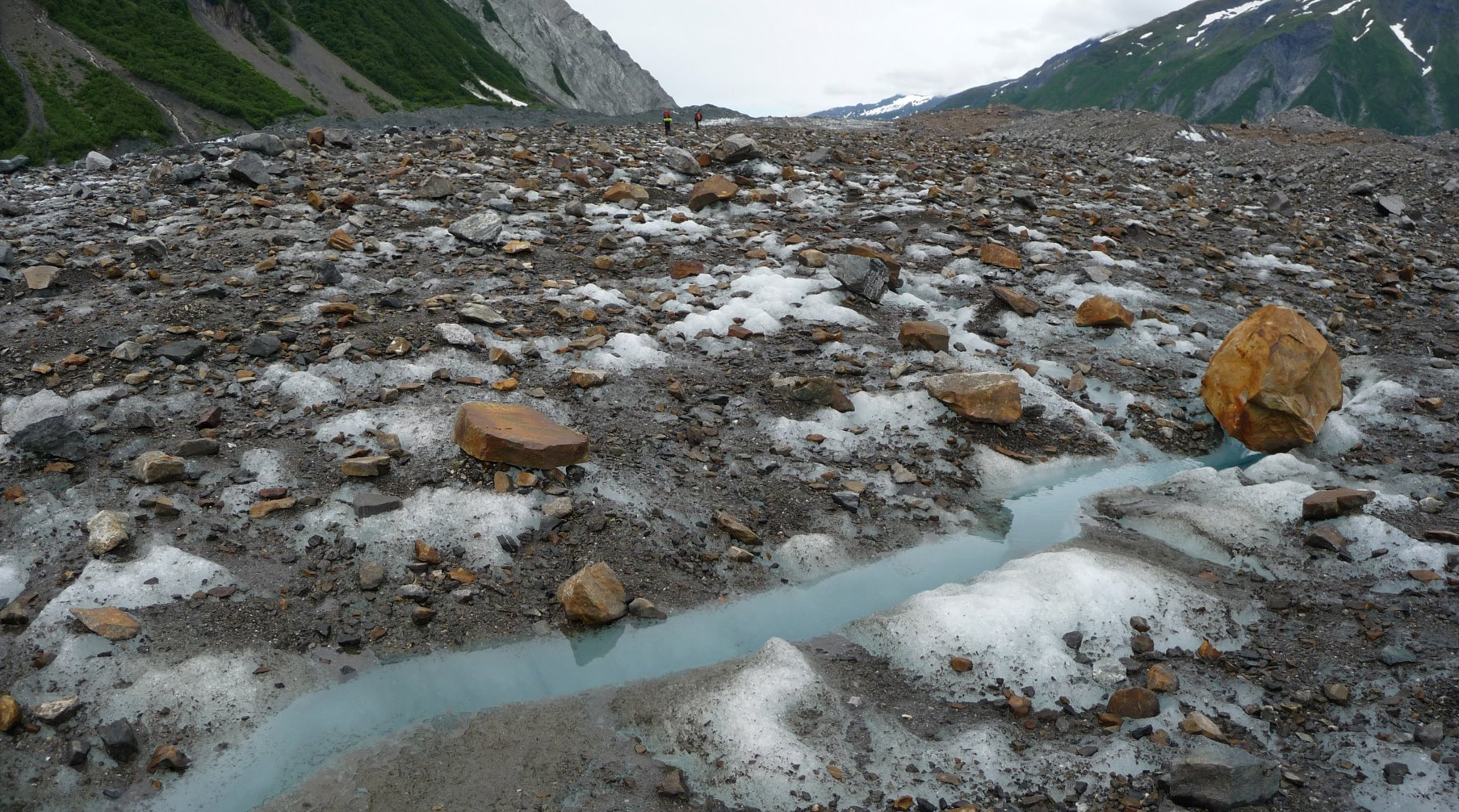 Lituya Glacier covered in a layer of rock.