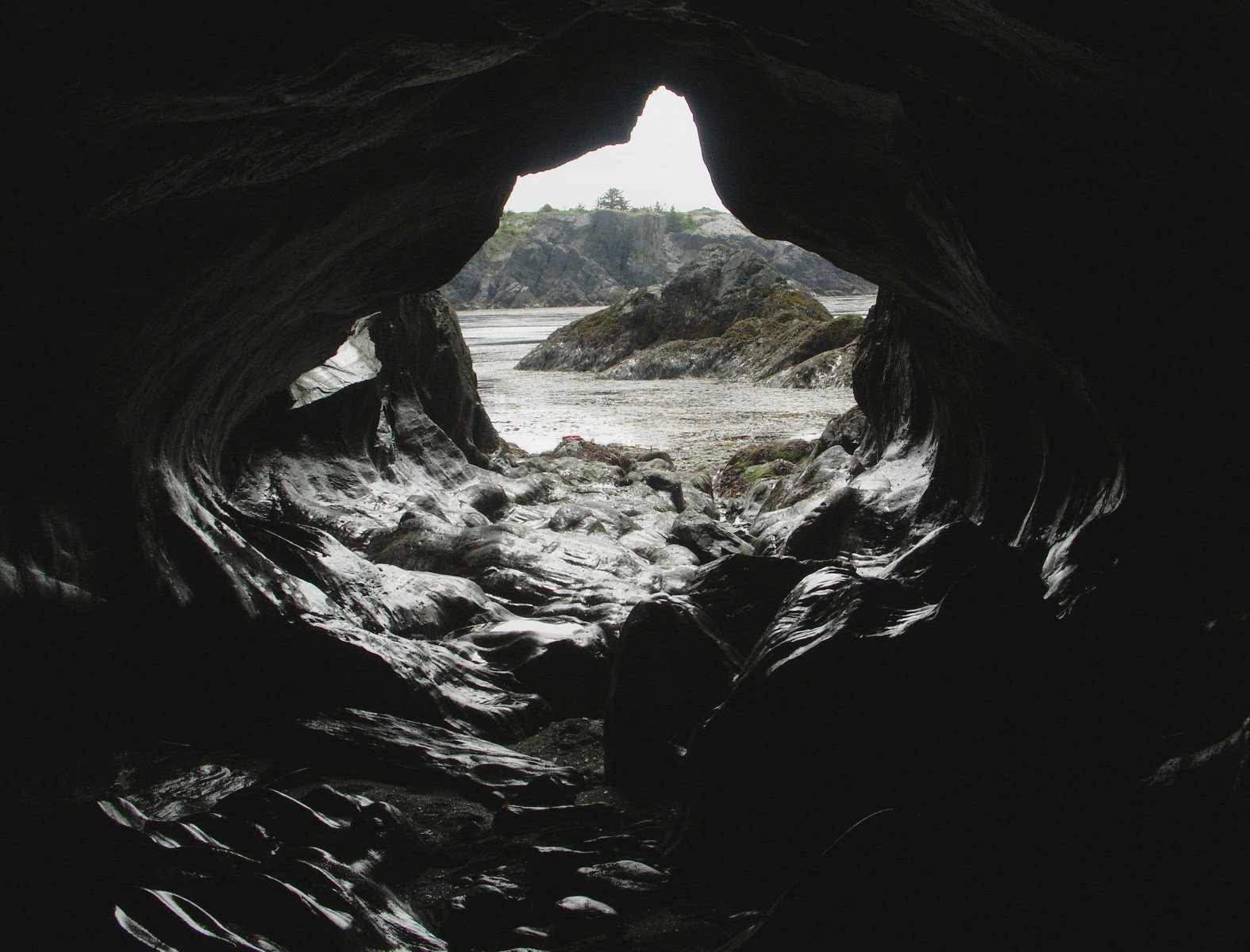 Sea cave and sea arch rock formations.