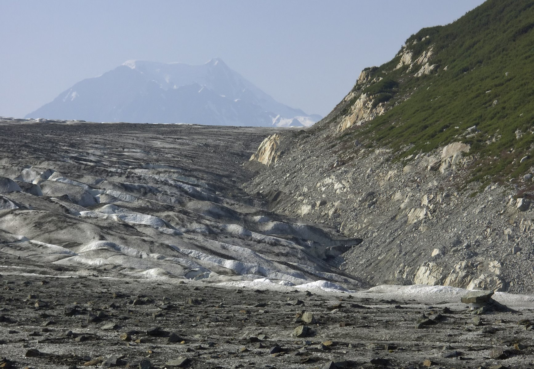 Transition between ice and land on glacier hike.