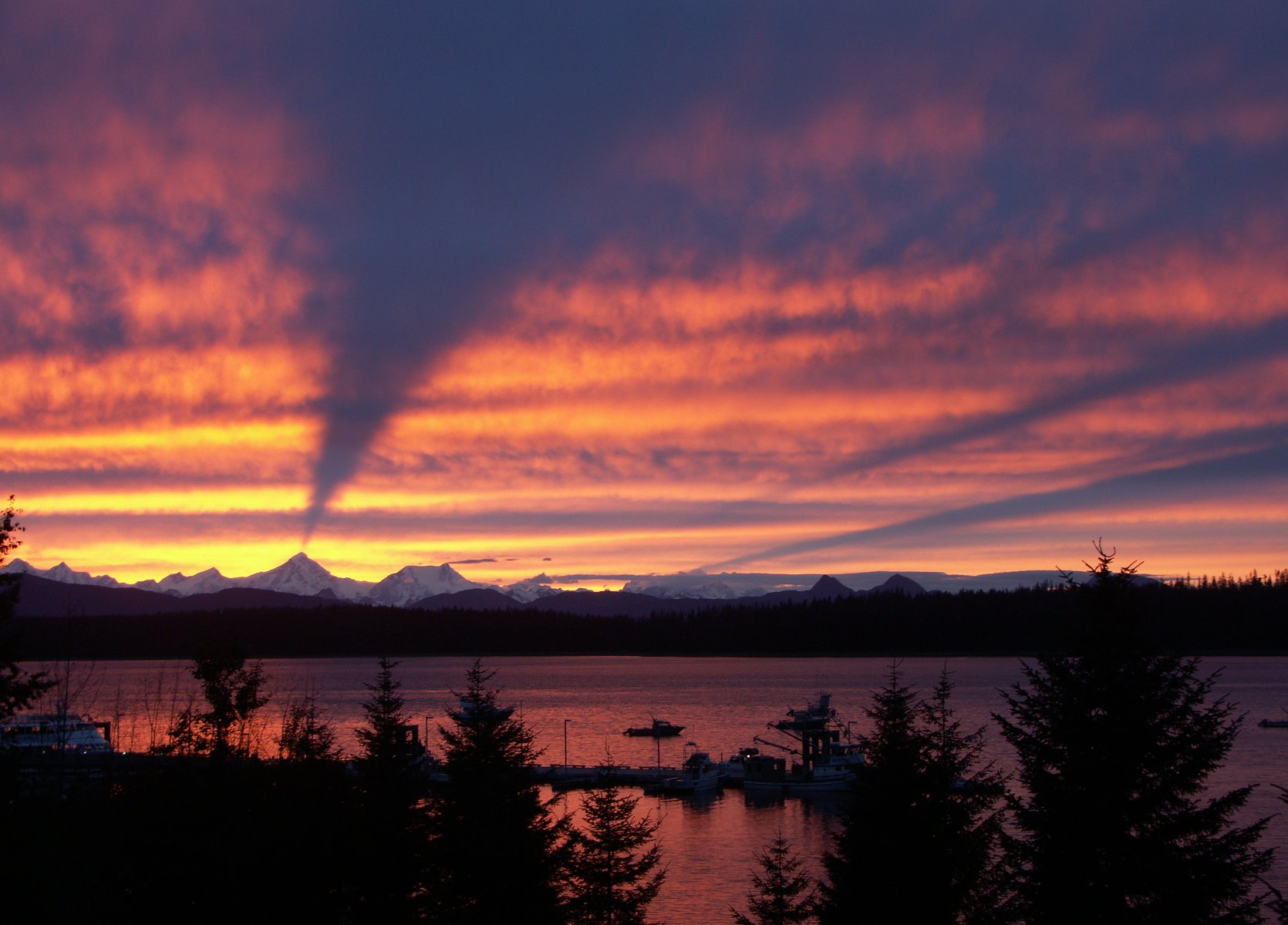 Sunset from Bartlett Cove with the Fairweather Mountains in the background.